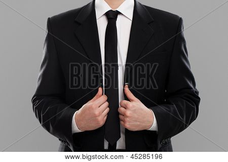 Businessman's torso in suit over grey background