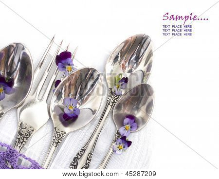 silverware with violets as a menu