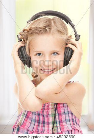 picture of happy girl in big headphones