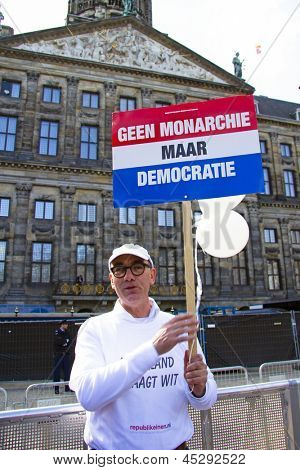 AMSTERDAM, NETHERLANDS - APRIL 30: Man demonstrating on damsquare for ' no monarchie, but democratie'  at the coronation of the new king Willem Alexander on 30 april 2013 in Amsterdam the Netherlands