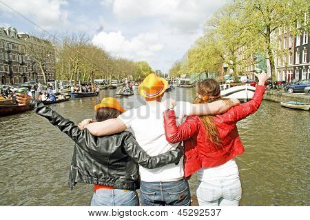AMSTERDAM, NETHERLANDS - APRIL 30: Happy people are celebrating the coronation of the new king Willem Alexander on 30 april 2013 in Amsterdam the Netherlands