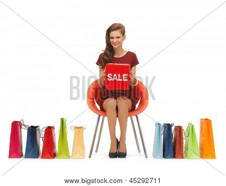 Bild der Frau mit Einkaufstüten und Verkauf Zeichen.