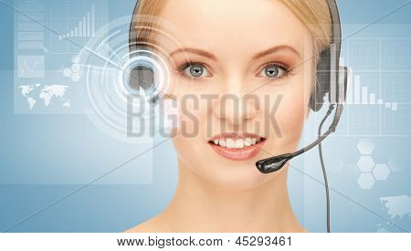 futuristic female helpline operator with headphones and virtual screen