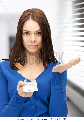 picture of unhappy woman with euro cash money