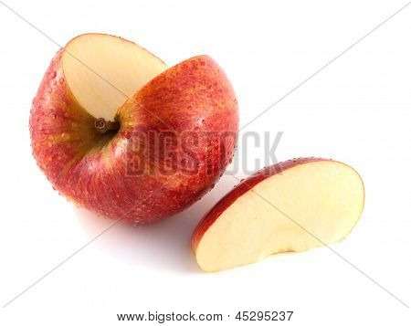 Isolated sliced red apple with one slice (wet)