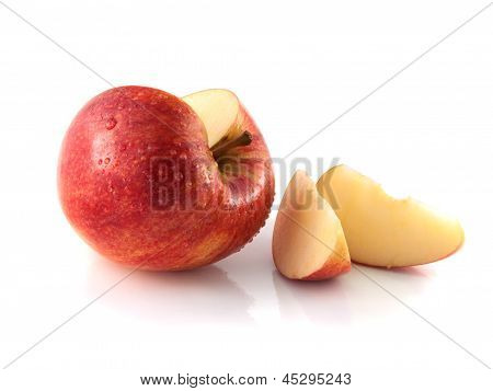 Isolated sliced red apple with two slices (wet)