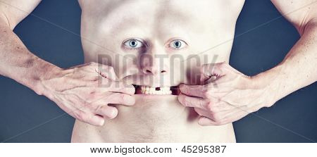 man with the face on the belly stretches mouth toothless smile