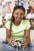 Teenage girl with game controller