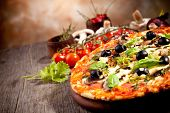 stock photo of cut  - Fresh italian pizza - JPG