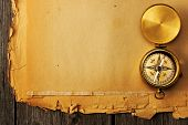 foto of geography  - Antique brass compass over old paper background - JPG