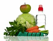 pic of water cabbage  - Fresh cabbage with tape measure and bottle of water over white background - JPG