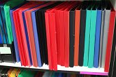 The image of loose-leaf binder stands on the shelf