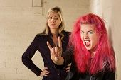stock photo of disapproval  - Teenager in pink hair with disapproving mother in background - JPG