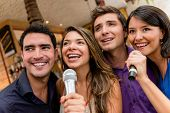 pic of karaoke  - Group of people karaoke singing at the bar having fun - JPG