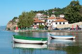 stock photo of macedonia  - two row boats in the bay of Ohrid Town on Ohrid Lake - JPG