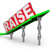 pic of payday  - The word Raise on an arrow lifted by workers who are asking for an increase in pay for a job well done - JPG