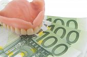 picture of denture  - denture and euro bills - JPG