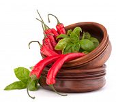 picture of chillies  - Hot red chili or chilli pepper in wooden bowls stack  isolated on white background cutout - JPG