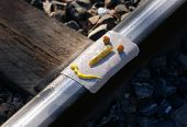 stock photo of amtrak  - Humorous spoof on Amtrak with a piece of ham and sandwich fixings laid out on railroad track - JPG