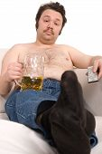 image of couch potato  - Overweight man sitting on the couch with a beer glass and remote control - JPG