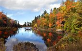 foto of shoreline  - Autumn is reflected in still waters on the Keweenaw Peninsula in Michigan - JPG