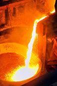stock photo of blast-furnace  - Pouring of liquid metal shoot inside the plant - JPG