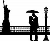 Romantic couple in New York under umbrella silhouette