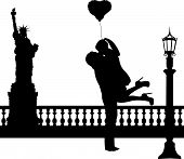 Couple in love with heart balloon in New York silhouette
