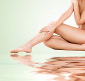 foto of bodyscape  - picture of healthy naked woman legs over green background - JPG