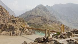 picture of karakoram  - Suspension bridge across the Indus River along the Karakorum Highway in Pakistan - JPG