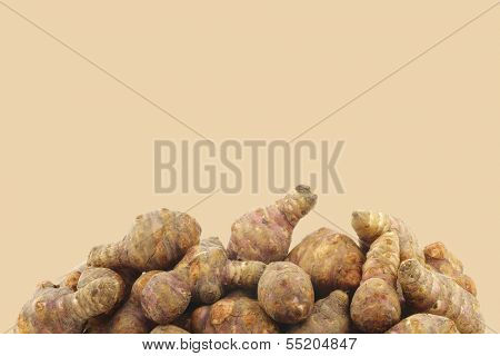 Bunch of topinambur roots (helianthus tuberosus) on a beige background