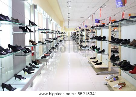 SAMARA, RUSSIA - JULY 7: A lot of women shoes on a glass shelf in a long hall of a shoe store with inscriptions Sale and indicating shoe size in shopping complex Kosmoport, July 7, Samara