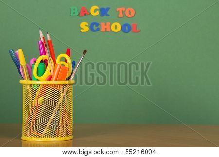 Pencils, scissors in a support