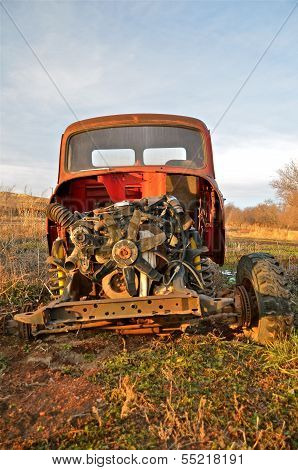 Old junker pick up stripped of body parts