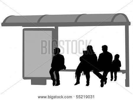Silhouettes of people at bus stop.