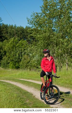 Young Woman With Mountain Bike In The Nature
