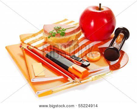Set of orange writing materials