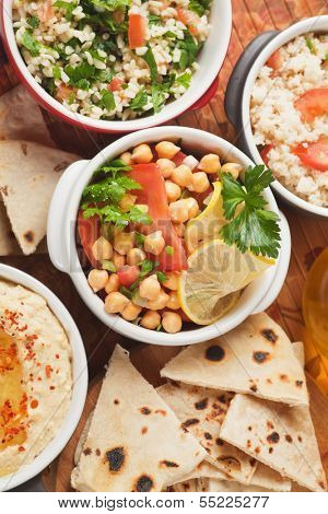 Chickpea salad with tabbouleh and pita bread