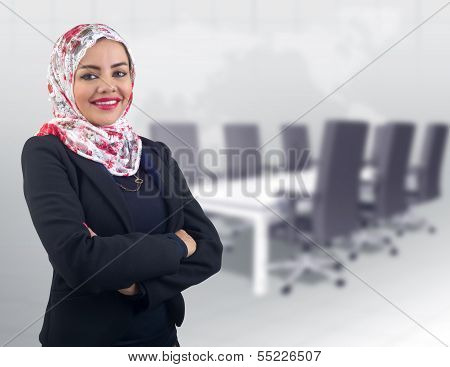 Arabian muslim business woman posing in the meeting room