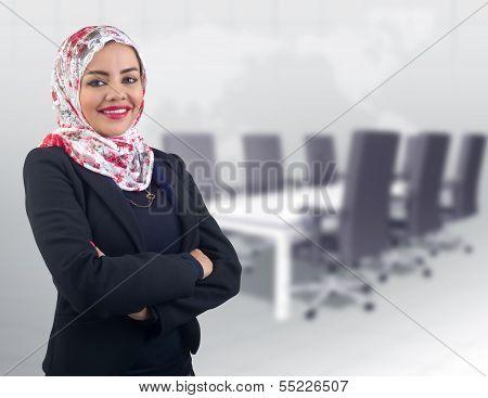 Arabian muslim business woman posing in the meeting room