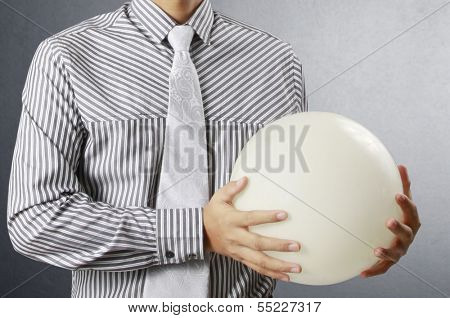 Businessman hand holding the Crystal Ball