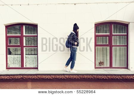 Young Woman Walking On Cornice