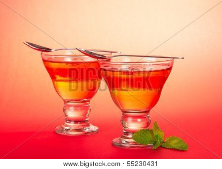 Two glasses of jelly with spearmint leaf