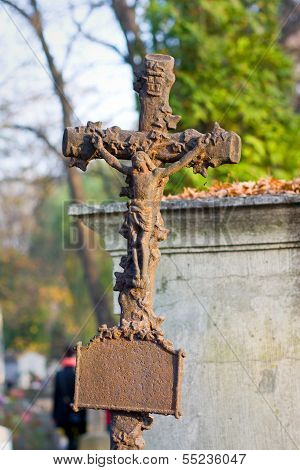 Cross With Crucified Jesus Christ At Cemetery