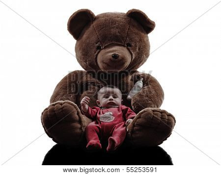 one caucasian new born baby posing with teddy bear silhouette on white background