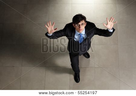 Image of young businessman in glasses. Top view