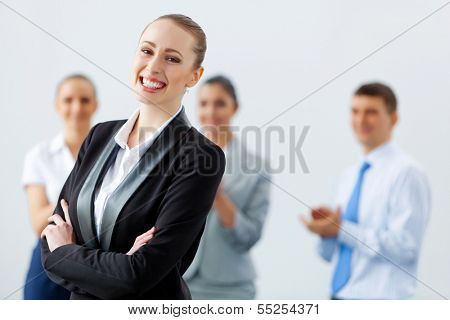 Image of four pretty young businesswomen standing in row