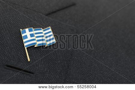 Greece Flag Lapel Pin On The Collar Of A Business Suit
