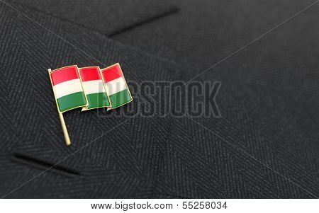 Hungary Flag Lapel Pin On The Collar Of A Business Suit