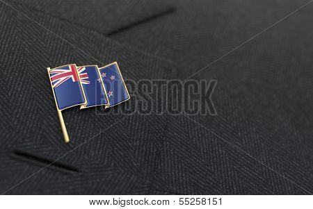 New Zealand Flag Lapel Pin On The Collar Of A Business Suit